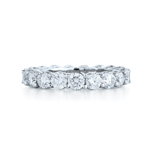 Round diamond wedding ring in a platinum shared prong setting