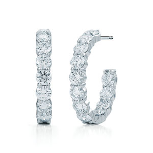 Diamond hoop earrings in a shared prong setting in 18K white gold, small sizes