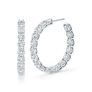 Shared prong diamond hoop earrings in 18K white gold with a 1.5 inch outside diameter, diamond size of 0.40 carats