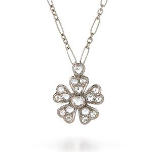 Diamond flower pendant in 18k white gold.